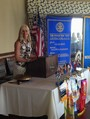 Wanda McIlvaine calls to order her first lunch meeting as President of the Woodbury Lunch Rotary Club.